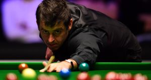 Ronnie O'Sullivan made a 147 but was knocked out in the first round of the China Open. Photograph: Justin Setterfield/Getty
