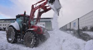 Snow-clearing at Bracetown Business Park in Dunboyne, Co Meath, during Storm Emma. Photograph: Alan Betson