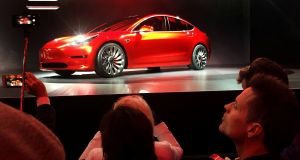 A Tesla Model 3 sedan at  its launch in Hawthorne, California,  in 2016. Photograph:  Reuters/Joe White