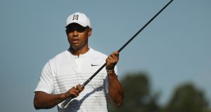Tiger Woods will play alongside Tommy Fleetwood and Marc Leishman at Augusta. Photograph: Patrick Smith/Getty