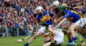Kilkenny's TJ Reid battles with  Tipperary's Michael Cahill, Brendan Maher and Cathal Barrett during the 2014 league final. Photo graph: James Crombie/Inpho