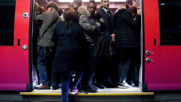 A train at the Gare Saint Lazare in Paris is packed with commuters on Tuesday, as a strike by rail workers severely hit services. Photograph: Etienne Laurent/EPA
