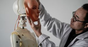 "An engineer works on robot at a lab of a doll factory of EXDOLL. With China facing a massive gender gap and a greying population, a company wants to hook up lonely men and retirees with ""smart"" sex dolls that can talk, play music and turn on dishwashers."