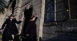 Micheline Sheehy Skeffington, granddaughter of leading Irish suffragette Hanna Sheehy Skeffington, re-enacts smashing the windows in Dublin Castle over 100 years ago. Photograph: Dara Mac Dónaill