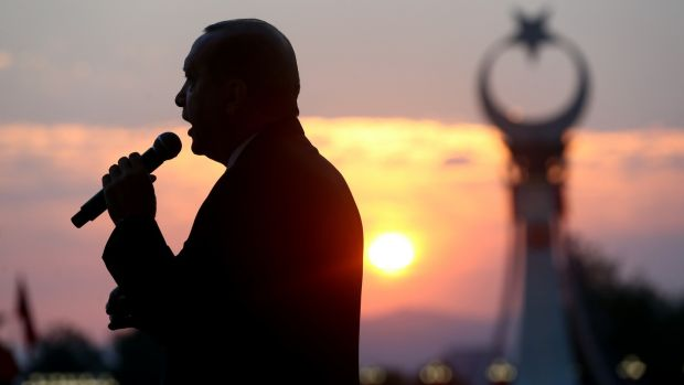 Recep Tayyip Erdogan delivering a speech outside the Presidential Palace in Ankara after a failed coup in July 2016. Photograph: Presidency Press Service via AP