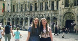 Hannah (left) with her friend Jenny in front of the 15th-century town hall in the Grand Place, Brussels.