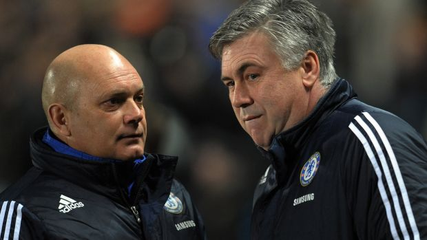 Ray Wilkins (L) with Carlo Ancelotti - the pair won the first league and cup double in Chelsea's history in 2009/10. Photograph: Paul Ellis/AFP