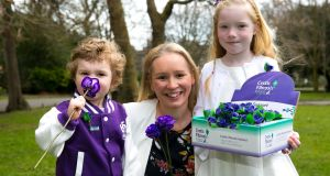 Siobhan Hannafin, from Sallins, Co Kildare,  with her children, Liam Hannafin, age 3, and Áine Hannafin, age 7, who has cystic fibrosis, at the launch of Cystic Fibrosis Ireland's 65 Roses Day fundraising appeal. Photograph: SON Photographic