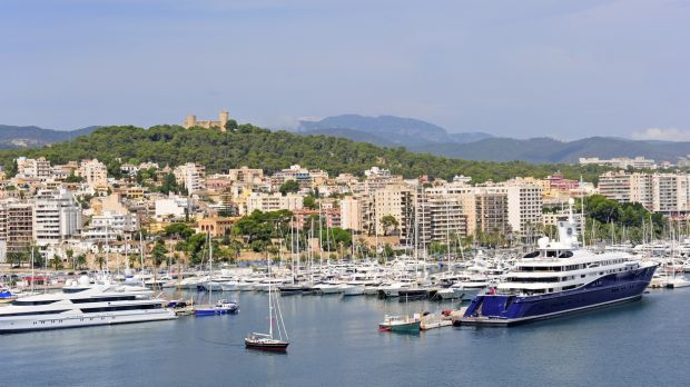 Marina in Palma De Majorca with Bellver castle on the hill.