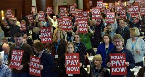 Delegates protest to Minister for Education Richard Bruton for equal pay at the Teachers' Union of Ireland congress in Wexford on Wednesday. Photograph: Tommy Clancy