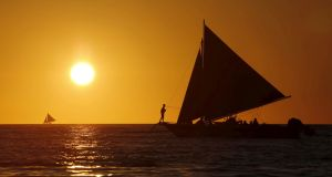 Tourists sailing near the island of Boracay in the Philippines. Irish residents spent a total of €6,891 million on outbound trips last year. Photograph: Charlie Saceda/Reuters.