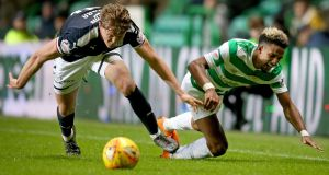 Scott Sinclair is tackled by Dundee's Mark O'Hara during Celtic's goalless draw at Parkhead. Photograph: Jane Barlow/PA