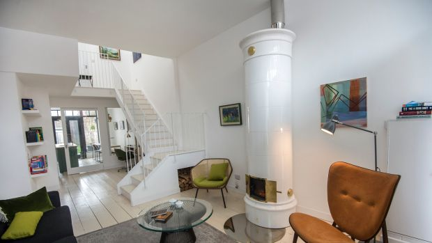 The living room with its contemporary stove looking down towards the kitchen on York Road, Dún Laoghaire. Photograph: Brenda Fitzsimons