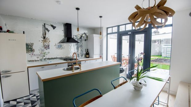 Interior designer Gillian Sherrard got the craftsman who was laying the skirting board to create doors for the kitchen in the former shop on York Road, Dún Laoghaire. Photograph: Brenda Fitzsimons