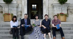 Winner of this year's Rooney Prize for Irish Literature Doireann Ní Ghríofa (centre) with Dr Patrick Prendergast, Provost of Trinity College Dublin, and previous winners, Sara Baume (left), Anne Enright and Kevin Barry. Photograph: Aidan Crawley
