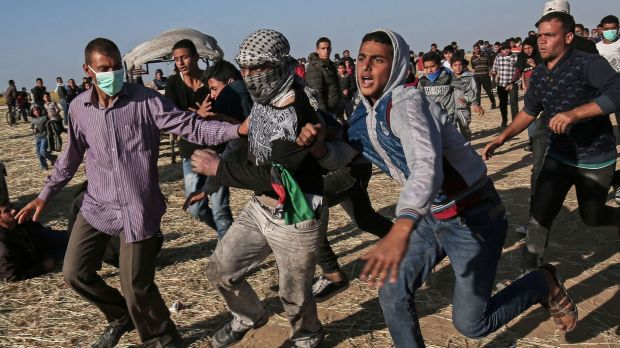 Protesters clash with Israeli security forces following a demonstration in the southern Gaza Strip in March. Photograph: Said Khatib/AFP/Getty Images