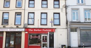 A three-storey, terraced house above a barbershop on Cork's Shandon Street is for sale for €210,000.