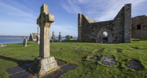 The Cross of the Scriptures in front of the cathedral at Clonmacnoise, Co Offaly, taken from Ireland's Ancient East – A Guide to its Historic Treasures by Neil Jackman, published by The Collins Press