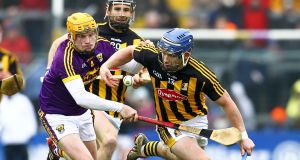 Wexford's Simon Donohoe tries to dispossess Kilkenny's Ger  Aylward during the league semi-final at Wexford Park. Photograph: Ken Sutton/Inpho