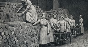 Women munition workers stacking a reserve of shell castings during the first World War. Photograph: Universal History Archive/UIG via Getty Images