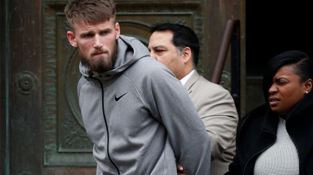 MMA fighter Cian Cowley walks out of the 78th police precinct after charges were laid against him. Photograph: Brendan McDermid/Reuters