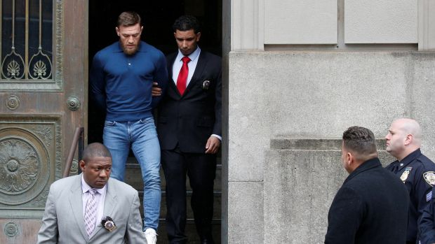 MMA fighter Conor McGregor walks out of the 78th police precinct after charges were laid against him. Photograph: Brendan McDermid/Reuters