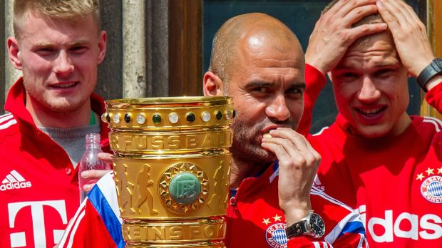 Head coch Pep Guardiola holds the trophy after Bayern Munich's German cup win over Borussia Dortmund ikn Berlin in 2014. Photograph: Marc Mueller/AP