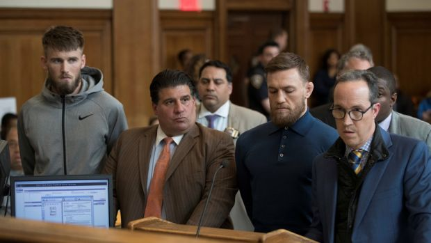 Mixed martial arts fighter Conor McGregor (2nd from right), and Cian Cowley (left), stand with lawyer Jim Walden (right), and John Arlia during their arraignment in a New York City courtroom on charges of assault. Photograph: Mary Altaffer/Reuters