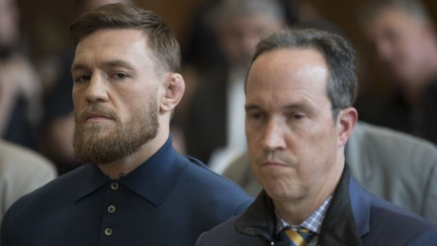 Conor McGregor stands with his lawyer Jim Walden during an arraignment in Brooklyn Criminal court. Photograph: Mary Altaffer/Getty Images