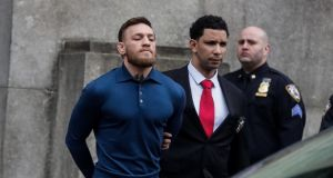 MMA fighter Conor McGregor walks out of the 78th police precinct after charges were laid against him following a late night melee in the Brooklyn borough of New York City. Photograph:  Jeenah Moon/Reuters