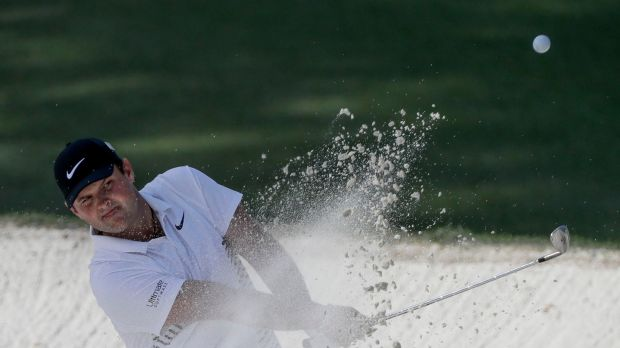 Reed hits from a bunker on the 10th hole. Photo: David J. Phillip/AP Photo