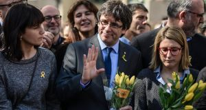 Former Catalan leader Carles Puigdemont poses with fellow politicians after a press conference in Berli. Photograph: EPA