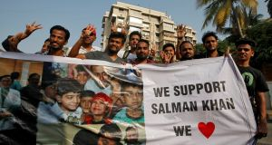 Fans of Bollywood actor Salman Khan hold a banner outside his house after a court in Jodhpur granted him bail. Photograph: Francis Mascarenhas/Reuters.