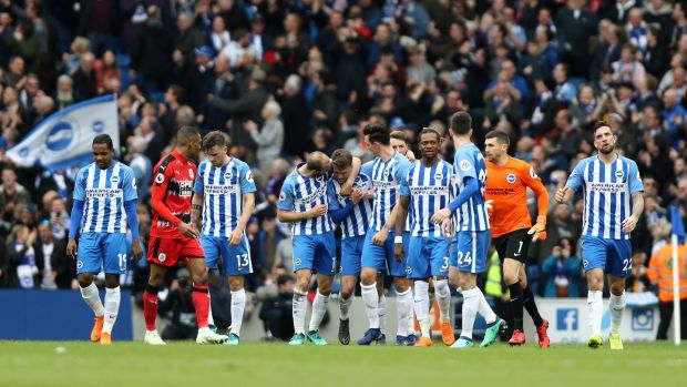 Brighton celebrate ther opener against Crystal Palace. Photograph: Bryn Lennon/Getty
