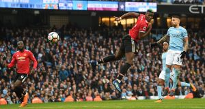 Paul Pogba heads home his and  Manchester United's second goal  during the Premier League match against Manchester City  at Etihad Stadium. Photograph: Michael Regan/Getty Images