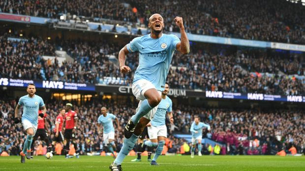 Vincent Kompany celebrates after giving Manchester City the lead in their Premier League match against Manchester United at Etihad Stadium. Photograph: Michael Regan/Getty Images