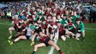 St Ronan's Lurgan celebrate with the Hogan Cup after the game. Photograph: Inpho