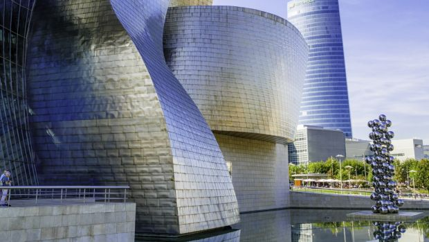 The Guggenheim Museum in Bilbao, a titanium-clad, iron-girded structure designed by Frank Gehry