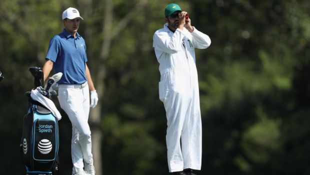 Jordan Spieth waits to play a shot with caddie Michael Greller during a practice round prior to the start of the 2018 Masters. Photograph: David Cannon/Getty Images