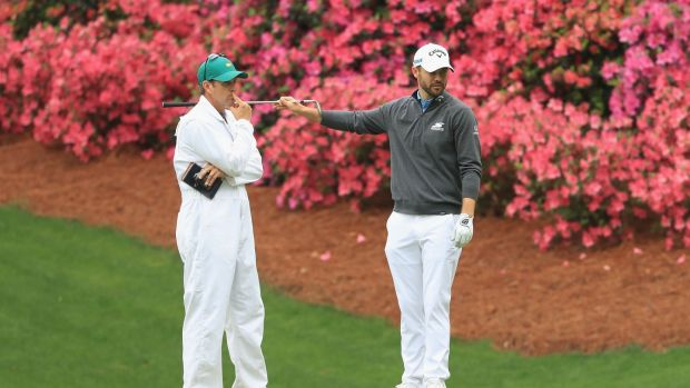 Wesley Bryan talks with his caddie William Lanier on the 13th hole during a practice round prior to the start of the 2018 Masters. Photograph: Andrew Redington/Getty Images