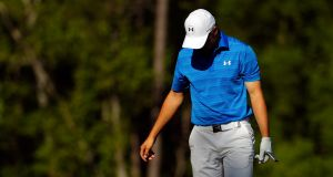 Jordan Spieth  reacts after hitting his tee shot into the water on the 12th hole during the final round of the 2016 Masters  at Augusta National Golf Club. Photograph: Kevin C Cox/Getty Images
