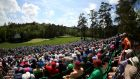 Patrons watch play at Amen Corner  at Augusta National Golf Club. Photograph: Mike Ehrmann/Getty Images