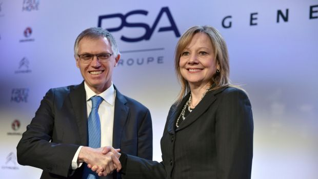 Carlos Tavares, CEO of PSA, and Mary Barra, CEO of General Motors: Barra is the only female chief executive at a major carmaker. Photograph: Zacharie Scheurer/AP