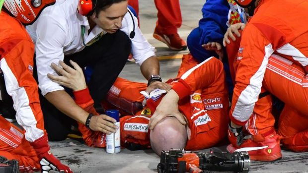 A pitman receives medical assistant after an incident with Kimi Raikkonen during the Bahrain Grand Prix. Photograph: Giuseppe Cacace/AFP