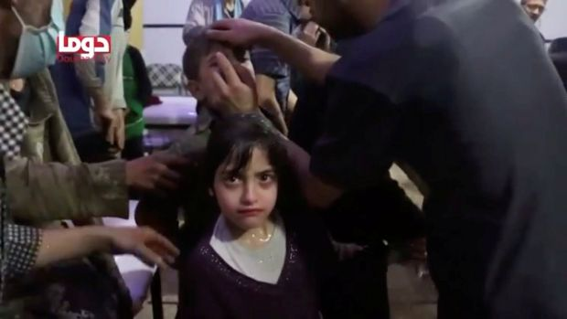 A girl looks on following an alleged chemical weapons attack, in what is said to be Douma, Syria in this still image from a video. Photograph: White Helmets/Reuters TV