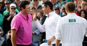 Rory McIlroy congratulates Patrick Reed after he won  the 2018 Masters tournament  in Augusta, Georgia. Photograph:  Mike Segar/Reuters