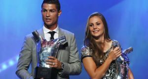 Ronaldo and Netherlands midfielder Lieke Martens with their respective 'Best Player in Europe' awards in Monaco. Photograph: Valery Hache/AFP/Getty