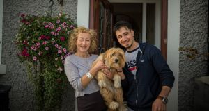 Mary O'Reilly outside her house in Baldoyle, Co Dublin,  with Syrian refugee Wassim Kharita. Photograph: CJ Nash