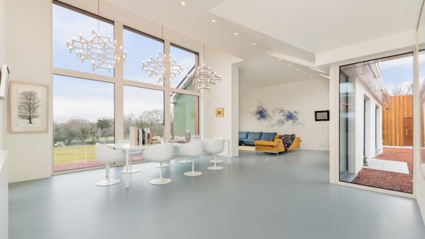 Flooring is a poured resin in a colour that mimics the lake and creates the effect of an infinity floor linking to the water
