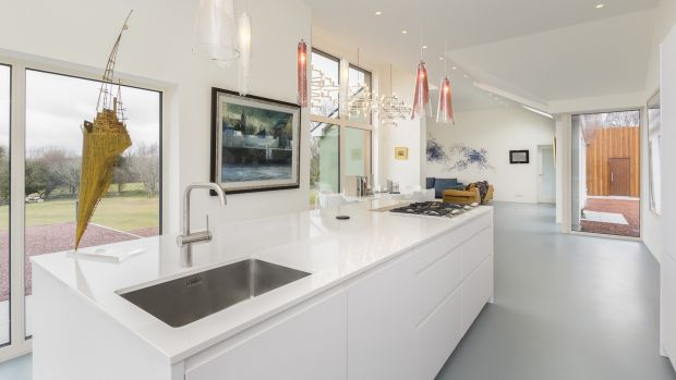 The kitchen, by McNally in Ballsbridge, has Gaggenau appliances including a wine cooler and retractable extractor fan
